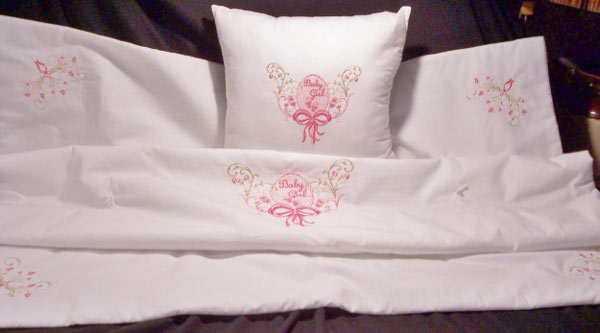 blanket and pillow with center and corner embroidery