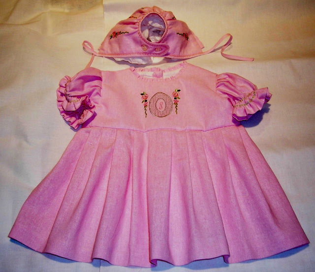pink linen dress and bonnet